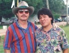 Jimmy Fong with his inspiration John Denver.