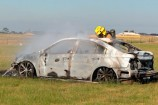 A fire crew extinguished an incinerated sports car at Botanic Ridge. 141517 Picture: GARY SISSONS