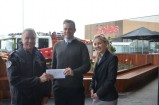 Cranbourne senior station officer Phillip Charles accepts a cheque from Springhill senior centre manager Mark Ensor and assistant asset manager Nicole Angel. 141989 Picture: DONNA OATES