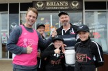 Jake draws the winning raffle ticket with Angela, Tyson, Brian and Sarah at Brian's Gourmet Meats. 158419 Picture: STEWART CHAMBERS